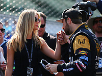 May 26, 2017; Indianapolis, IN, USA; IndyCar Series driver James Hinchcliffe (right) kisses the hand of girlfriend Rebecca Dalton prior to getting into his car during Carb Day for the 101st Running of the Indianapolis 500 at Indianapolis Motor Speedway. Mandatory Credit: Mark J. Rebilas-USA TODAY Sports