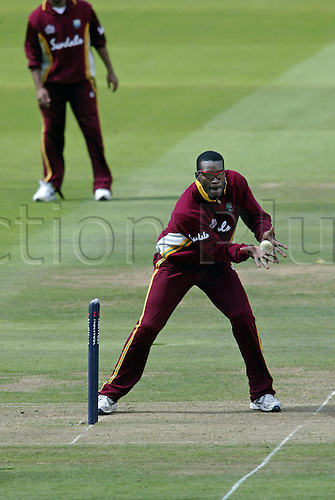 10 July 2004: West Indian all rounder Chris Gayle catching the ball by the stumps during the Natwest Series final between the West Indies and New Zealand at Lords. New Zealand won by 107 runs. Photo: Neil Tingle/Actionplus..040710 man men cricket cricketer catch