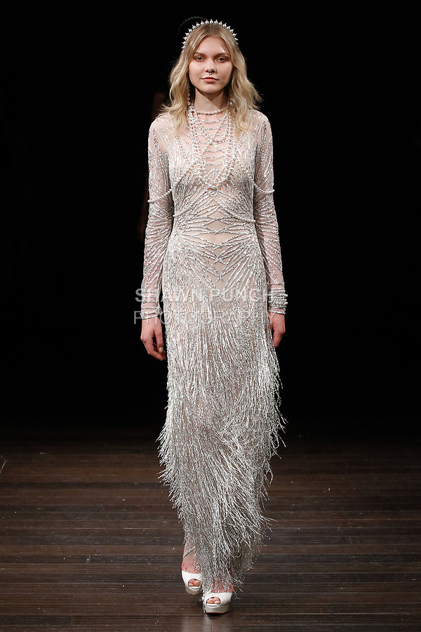 """Model walks runway in a """"Chrysler"""" gown from the Naeem Khan Bridal Spring 2018 collection, on April 21, 2017; during New York Bridal Fashion Week."""