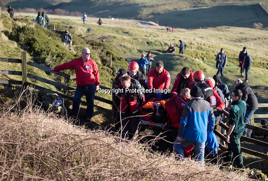 02/01/17<br /> <br /> Pictured are the Buxton Mountain rescue crew rescuing a woman who slipped and injured her ankle on Mam Tor near Castleton.<br /> <br /> Mountain Rescue teams are currently responding to multiple call outs in the Derbyshire Peak District after fine weather is attracting hundreds of Bank Holiday walkers onto ice covered hills. <br /> <br /> All Rights Reserved F Stop Press Ltd. (0)1773 550665   www.fstoppress.com