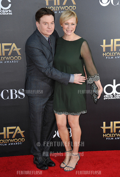 Mike Myers &amp; Kelly Tisdale at the 2014 Hollywood Film Awards at the Hollywood Palladium.<br /> November 14, 2014  Los Angeles, CA<br /> Picture: Paul Smith / Featureflash