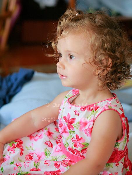 little girl sitting candid portrait. David Shwatal portrait photographer Tinley Park Chicago IL 60477