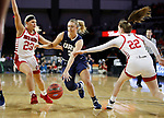 SIOUX FALLS, SD - MARCH 8: Katie Kirkhart #3 of Oral Roberts drives between South Dakota defenders Madison McKeever #23 and Chloe Lamb #22 at the 2020 Summit League Basketball Championship in Sioux Falls, SD. (Photo by Richard Carlson/Inertia)