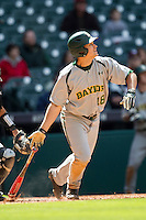 Baylor Bears designated hitter Kameron Esthay (18) follows through on his swing during Houston College Classic against the Hawaii Rainbow Warriors on March 6, 2015 at Minute Maid Park in Houston, Texas. Hawaii defeated Baylor 2-1. (Andrew Woolley/Four Seam Images)