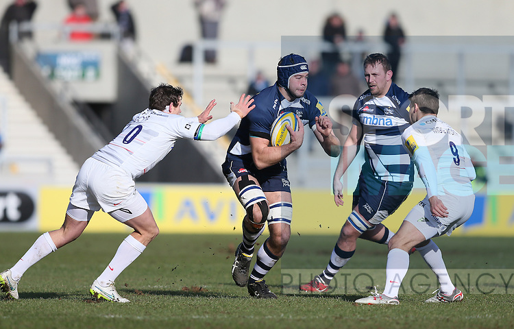 Josh Beaumont  of Sale Sharks charges past Alex Goode and Richard Wigglesworth of Saracens   - Aviva Premiership - Sale Sharks vs Saracens - AJ Bell Stadium Stadium - Salford - Manchester - England - 21st February 2015 - Picture Simon Bellis/Sportimage