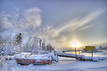 Boat under snow in Yellowknife Bay