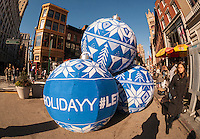 "A promotional event for Skyy Vodka in Union Square in New York on Friday, December 4, 2015 uses the craft of 'knit bombing"" to wrap promotional items with yarn. Knit bombing, graffiti knitting, yarn bombing, etc., uses knitted or crocheted yarn as opposed to chalk or paint. (© Richard B. Levine)"