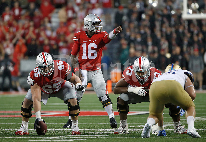 Ohio State Buckeyes quarterback J.T. Barrett (16) calls a play during the fourth quarter of the NCAA football game between the Ohio State Buckeyes and the Tulsa Golden Hurricane at Ohio Stadium on Saturday, September 10, 2016. (Columbus Dispatch photo by Jonathan Quilter)