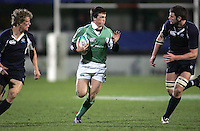 Irish centre Eoin O'Malley races for the Scottish line during the Division A clash in the U19 World Championship at Ravenhill.