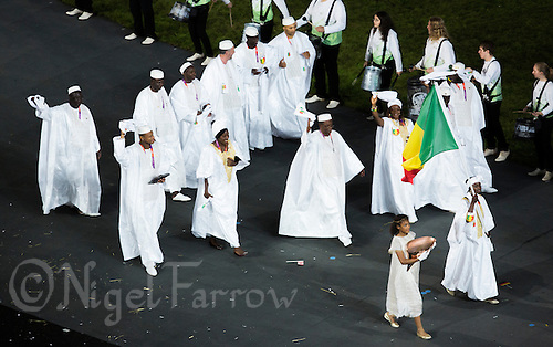 27 JUL 2012 - LONDON, GBR - Athlete Rahamatou Drame (MLI) leads the team from Mali around the Olympic Stadium during the Opening Ceremony of the London 2012 Olympic Games in Stratford, London, Great Britain (PHOTO (C) 2012 NIGEL FARROW)
