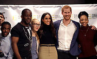 01 December 2017 - Prince Harry and Meghan Markle pose for a photograph with the cast of a hip hop opera performed by young people involved in the Full Effect programme at the Nottingham Academy school in Nottingham, Nottinghamshire where they met head teachers, pupils, staff and mentors involved in the Full Effect programme. The couple took part in their first official visit together, choosing to raise awareness of HIV/AIDS with a visit to a youth project in Nottingham, Nottinghamshire. Photo Credit: ALPR/AdMedia
