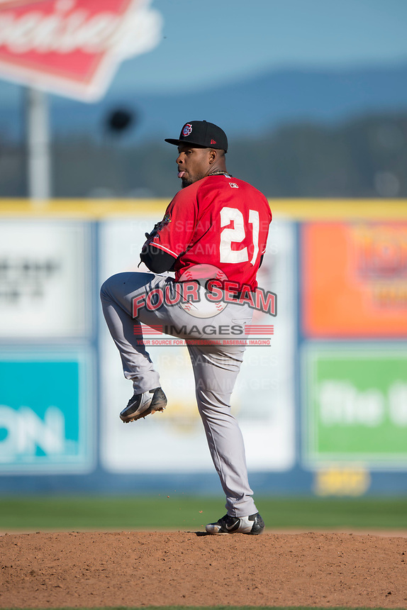 Vancouver Canadians relief pitcher Orlando Pascual (21) delivers a pitch during a Northwest League game against the Spokane Indians at Avista Stadium on September 2, 2018 in Spokane, Washington. The Spokane Indians defeated the Vancouver Canadians by a score of 3-1. (Zachary Lucy/Four Seam Images)