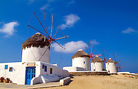 Beautiful scenic color of white famous windmills on beach of beautiful island of Mykonos Greece
