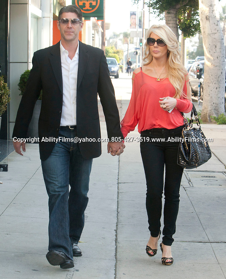 .March 22nd 2012   ..Gretchen Rossi shopping on Robertson blvd in Beverly Hills with her husband. .Big black designer purse handbag goo ..AbilityFilms@yahoo.com.805-427-3519.www.AbilityFilms.com.