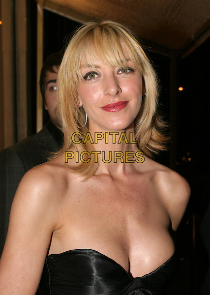 KAT MACK.Roberto Cavalli - store launch party .May 13th, 2004.headshot, portrait, strapless, cleavage.www.capitalpictures.com.sales@capitalpictures.com.© Capital Pictures.