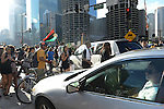 Demonstrators block traffic on State Street at Wacker Drive in support of a Citizens Police Accountability Council to provide civilian oversight of the Chicago Police Department in Chicago, Illinois on July 11, 2016.  The demonstration attracted a larger crowd on the heels of last week's racially charged police shootings captured on video of Alton Sterling in Baton Rouge, Louisiana and Philando Castile in the St. Paul suburb of Falcon Heights, Minnesota which was followed by a mass shooting of five police officers by Afghan War veteran Micah Johnson who supported radical and violent black nationalist ideology.