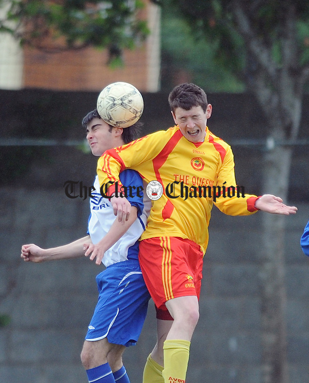 Eoin Keenan of Ennis Town contests an aerial ball with Sean Corry. Photograph by Declan Monaghan