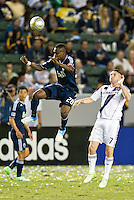 CARSON, CA - June 23, 2012: Vancouver Whitecaps midfielder Gershon Koffie (28) and LA Galaxy forward Robbie Keane (7) during the LA Galaxy vs Vancouver Whitecaps FC match at the Home Depot Center in Carson, California. Final score LA Galaxy 3, Vancouver Whitecaps FC 0.