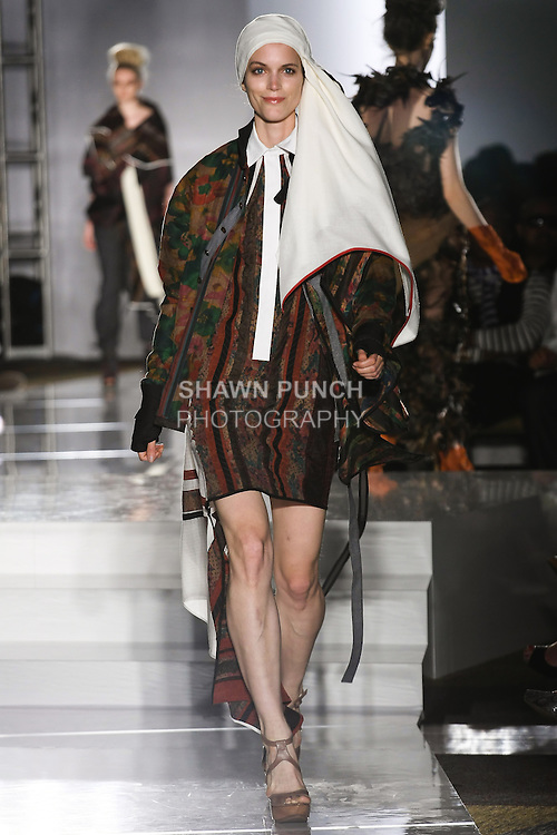 Model walks runway in an outfit by Carmen Chen Wu, for the Parsons 2011 BFA Fashion Show, hosted by Reed Krakoff.