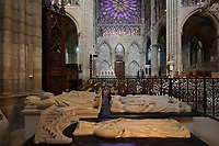 Effigy of Isabelle of Aragon, 1247-71, wife of Philip III the Bold, made 1275 in marble, with a black base with rhyming inscription which survived the Revolution, in the Basilique Saint-Denis, Paris, France. Behind on the left are Clovis II, 635-57, king of Neustria and Burgundy 639-57, and Charles Martel, 685-741, mayor of the palace of Austrasia of Neustria and Burgundy 721-41, both commissioned by Saint-Louis and made in stone 1263-64. Behind on the right are Philippe IV the Fair, 1268-1314, and Philippe III the Bold, 1245-85. The basilica is a large medieval 12th century Gothic abbey church and burial site of French kings from 10th - 18th centuries. Picture by Manuel Cohen