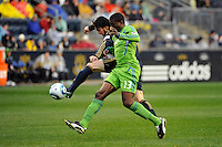 Danny Califf (4) of the Philadelphia Union plays the ball away from O'Brian White (13) of the Seattle Sounders FC. The Philadelphia Union and the Seattle Sounders FC played to a 1-1 tie during a Major League Soccer (MLS) match at PPL Park in Chester, PA, on April 16, 2011.