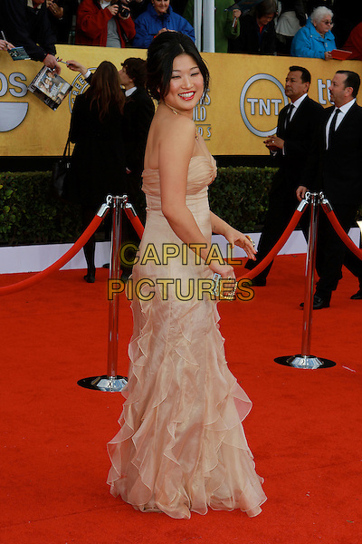 JENNA USHKOWITZ.17th Annual Screen Actors Guild Awards held at The Shrine Auditorium, Los Angeles, California, USA..January 30th, 2011.arrivals SAG full length dress strapless beige sheer clutch bag side gold clutch bag .CAP/ADM/KB.©Kevan Brooks/AdMedia/Capital Pictures.