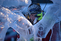 Keven Laughlin fill cracks on his sculpture of a Warhammer character on the final morning of the 2016 Crystal Gallery of Ice Ice Carving Competition in town square.