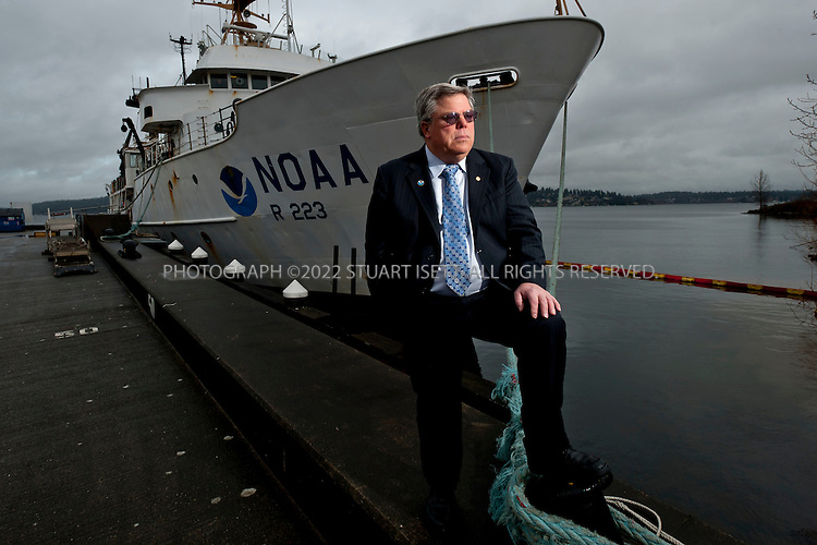 1/12/2011--Seattle, WA, USA..Richard Feely, PHD, senior scientist at NOAA, posing by one of the ships used for research from the NOAA center in Seattle's Sandpoint neighborhood on Lake Washington...©2011 Stuart Isett. All rights reserved.