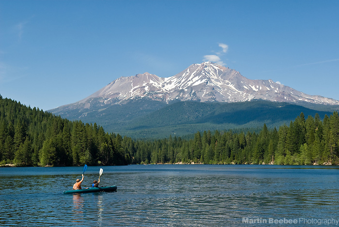 A father and son kayak on Lake Siskiyou below Mount Shasta, summer, Shasta-Trinity National Forest, California