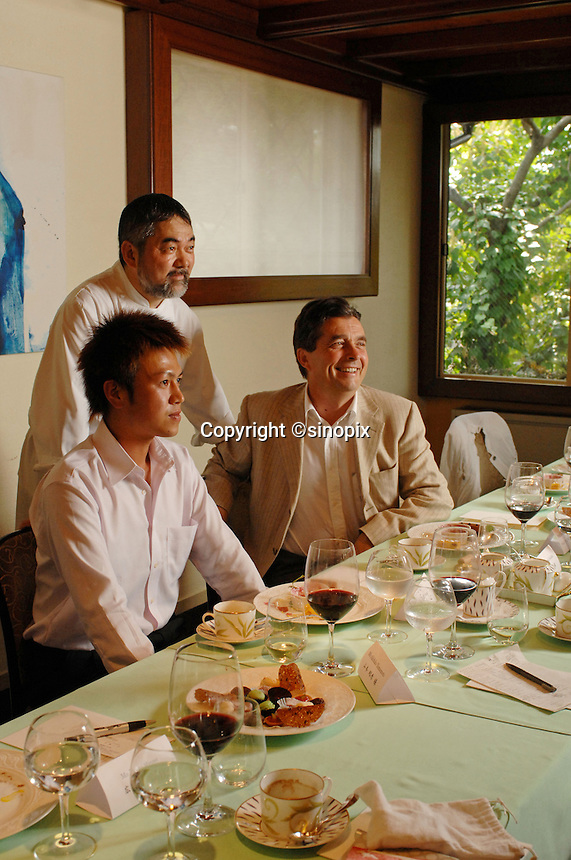 Denis Dubourdieu eats at the Mikuni restaurant in the  Tokyo.  Chef Mikuni is the most famous chef in Japan.   Mr  Dubourdieu was in Japan to promote a new Japanese wine that he is helping to create.