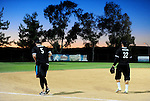 POWAY, CA - JULY 16:  Punter Mike Scifres and Safety Eric Weddle of the San Diego Chargers take to the field during their game in the Regular Joe League at the Poway Sportsplex Softball Field on July 16, 2014 in Poway, California. (CREDIT: Donald Miralle for the Wall Street Journal) <br /> chargers