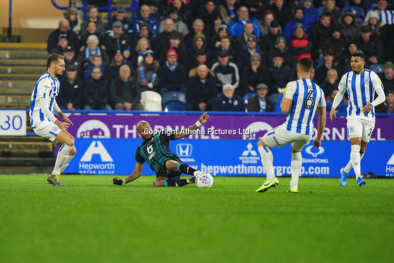 Andre Ayew of Swansea City in action during the Sky Bet Championship match between Huddersfield Town and Swansea City at The John Smith's Stadium in Huddersfield, England, UK. Tuesday 26 November 2019