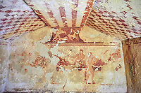 """Underground Etruscan tomb Known as """"Tomba della Caccia al Cervo"""" A single chamber with double sloping ceiling. On the back wall is painted a banquet scene with three couples lying on beds (Klinai). On the dide walls are dancers and musicians. Circa 450 BC. Excavated 1960 , Etruscan Necropolis of Monterozzi, Monte del Calvario, Tarquinia, Italy. A UNESCO World Heritage Site."""