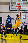3 March 2018: University of Vermont Guard Trae Bell-Haynes, a Senior from Toronto, Ontario, lays one up in the second half of the America East quarterfinals against Maine at Patrick Gymnasium in Burlington, Vermont. The Catamounts defeated the Black Bears 75-60 to move onto the AE semi-finals. Mandatory Credit: Ed Wolfstein Photo *** RAW (NEF) Image File Available ***