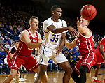 BROOKINGS, SD - FEBRUARY 23: Douglas Wilson #35 of the South Dakota State Jackrabbits passes out of a double team by Tyler Hagedorn #25 and Tyler Peterson #22 of the South Dakota Coyotes Sunday at Frost Arena in Brookings, SD. (Photo by Dave Eggen/Inertia)