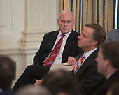 White House Chief of Staff John Kelly listens as United States President Donald J. Trump hosts the 2018 White House Business Session with  Governors, February 26, 2018, at The White House in Washington, DC. <br />