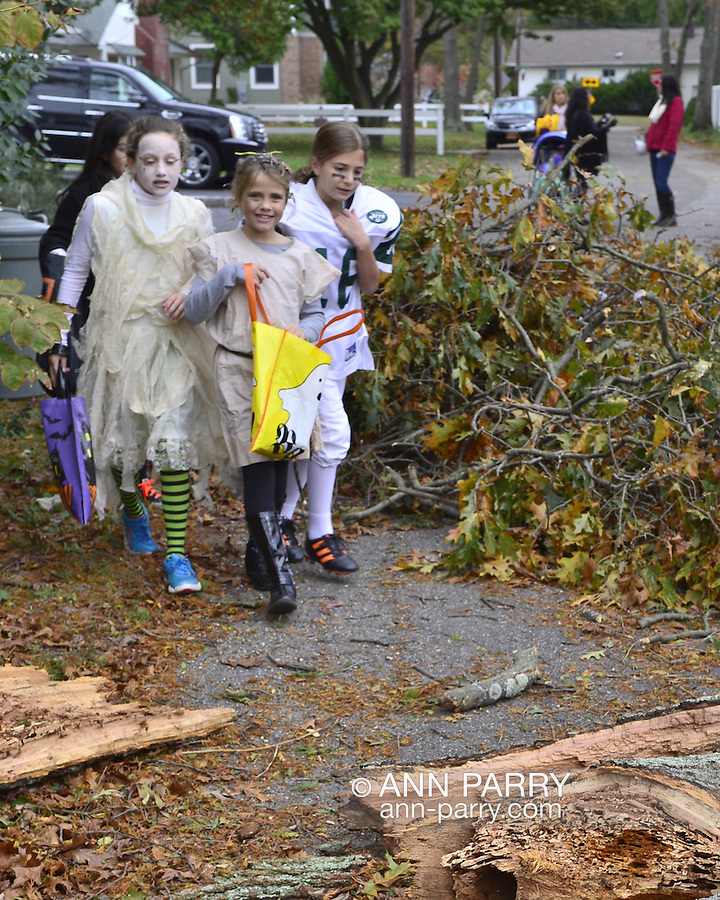 Oct. 31, 2012 - Merrick, New York - Hurricane Sandy major damage - flooding, fallen trees and power lines - doesn't stop Halloween Trick-or-Treaters on Long Island.