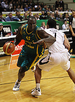 Boomers forward Nathan Jawai goes around Mika Vukona during the International basketball match between the NZ Tall Blacks and Australian Boomers at TSB Bank Arena, Wellington, New Zealand on 25 August 2009. Photo: Dave Lintott / lintottphoto.co.nz