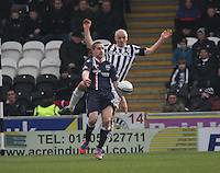 GaryGlen shields from Jim Goodwin in the St Mirren v Ross County Clydesdale Bank Scottish Premier League match played at St Mirren Park, Paisley on 19.1.13.