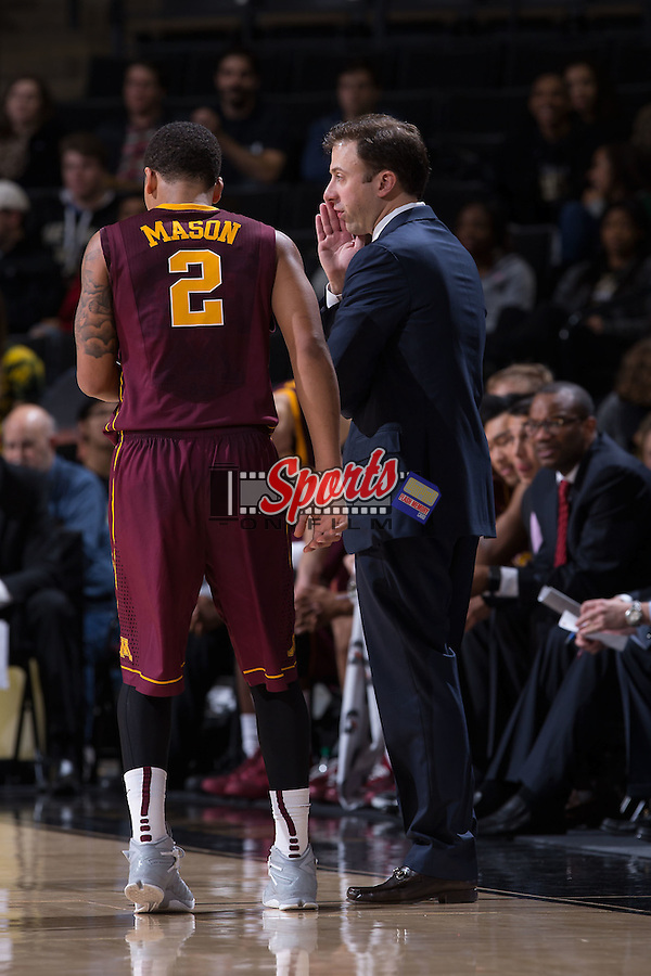 Minnesota Golden Gophers head coach Richard Pitino gives instructions to Nate Mason (2) during second half action against the Wake Forest Demon Deacons at the LJVM Coliseum on December 2, 2014 in Winston-Salem, North Carolina.  The Golden Gophers defeated the Demon Deacons 84-69. (Brian Westerholt/Sports On Film)