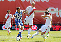 Rayo Vallecano's Alejandro Galvez (c) and Anaitz Arbilla (r) and Real Sociedad's Xabi Prieto during La Liga match.April 14,2013. (ALTERPHOTOS/Acero)