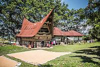 Rice drying in front of a traditional Batak House, Lake Toba (Danau Toba), North Sumatra, Indonesia