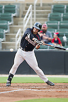 Brett Austin (10) of the Kannapolis Intimidators swings at the baseball during the game against the Lakewood BlueClaws at CMC-NorthEast Stadium on July 20, 2014 in Kannapolis, North Carolina.  The Intimidators defeated the BlueClaws 7-6. (Brian Westerholt/Four Seam Images)