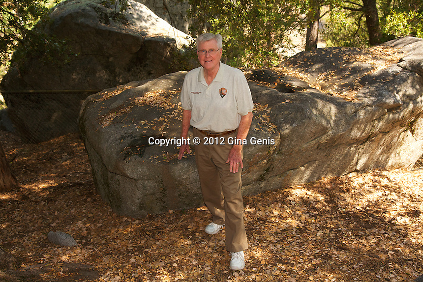 Bob Clopine standing next to the Indian grinding rock near the pictograph