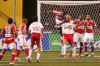 Chicago Fire midfielder (4) Bakary Soumare goes for a header over New York Red Bulls midfielder (13) Clint Mathis. The New York Red Bulls defeated the Chicago Fire 1-0 during an MLS regular season match at Giants Stadium, East Rutherford, NJ, on September 1, 2007.