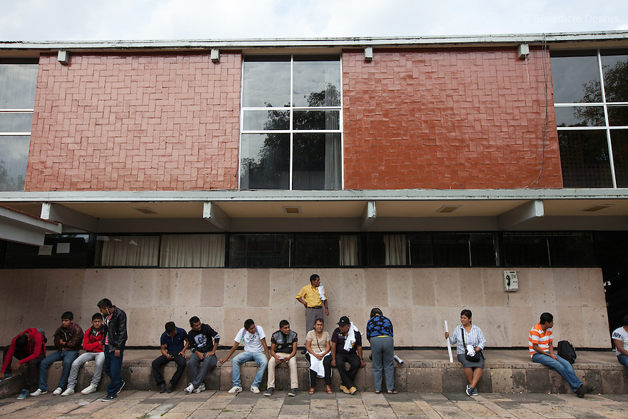 Parents and relatives of the 43 missing students from Ayotzinapa's teacher training college and classmates, sit in the patio of the teacher training college in Morelia, Michoacan, Mexico on November 19, 2014. The relatives of the 43 missing students still do not believe the official line that the young men are all dead, and with classmates, social organizations and human rights defenders, they started on Thursday a national caravan. They split up into three different caravans, branching out to share information face to face with supporters in other cities and rally nationwide support. The three groups will meet in Mexico City on Thursday 20 for a general strike and massive marches to demand justice and fight against corrupted government and organized crime. Criticism of the government has intensified in Mexico, and many are demanding that the search for the 43 missing students continue until there is concrete evidence to the contrary. (Photo by Bénédicte Desrus)