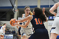 Har-Ber forward Mary Blake Martfeld (20) drives the ball as Heritage guard Quiara Jones (10) covers, Friday, February 7, 2020 during a basketball game at Wildcat Arena at Har-Ber High School in Springdale. Check out nwaonline.com/prepbball/ for today's photo gallery.<br /> (NWA Democrat-Gazette/Charlie Kaijo)