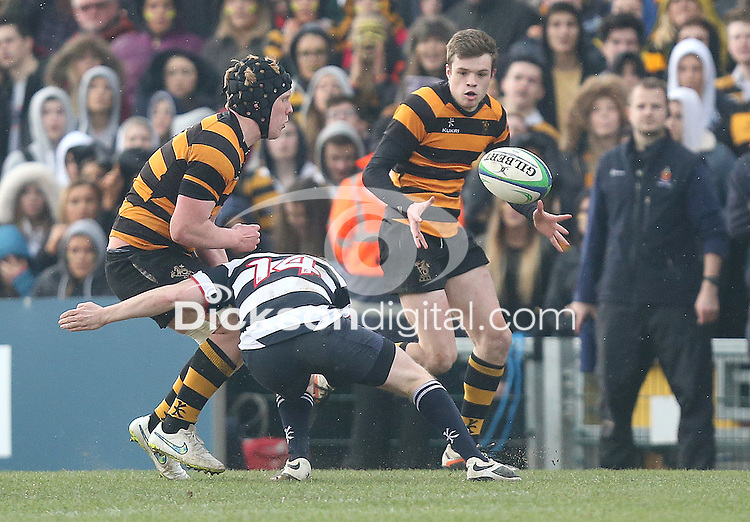 2015 ULSTER SCHOOLS CUP FINAL | Tuesday 17th March 2015<br /> <br /> Mark Mairs passes to Callum McLaughlin during the 2015 Ulster Schools Cup Final between RBAI and Wallace High School at the Kingspan Stadium, Ravenhill Park, Belfast, Count Down, Northern Ireland.<br /> <br /> Picture credit: John Dickson / DICKSONDIGITAL
