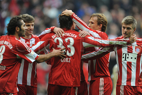 Bayern Munich's Mario Gomez (number 33) celebrates his goal for a 1-0 lead with his team mates during German Bundesliga match FC Bayern Munich vs Hanover 96 in the Allianz Arena in Munich, Germany, 16 October 2010.
