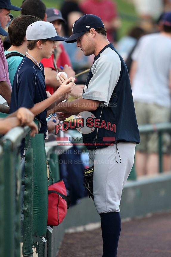 September 4, 2009:  Pitcher Kevin Whelan of the Scranton Wilkes-Barre Yankees signs autographs before a game at Frontier Field in Rochester, NY.  Scranton is the Triple-A International League affiliate of the New York Yankees and clinched the North Division Title with a victory over Rochester.  Photo By Mike Janes/Four Seam Images